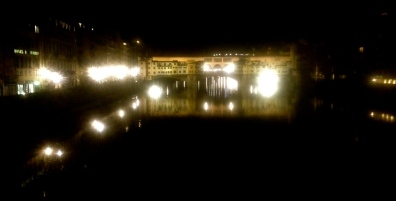 Ponte Vicchio at night, killing time with Caitlin sitting on the bridge